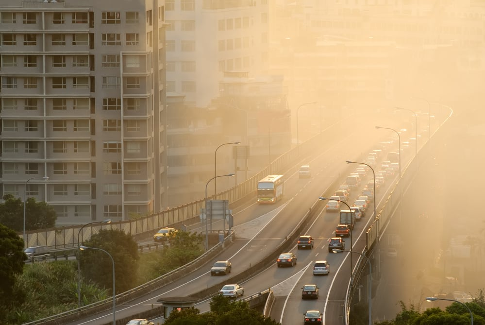 Air pollution in busy city, near highway and apartment buildings